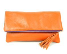 ba6981adc13e ORANGE FOLD OVER CLUTCH W PURPLE ZIPPER Orange Clutches