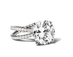 Round diamond engagement ring with crossover band  Crossover pavé engagement ring. Range: 0.50-5 carats platinum    David Yurman, price upon request, davidyurman.com