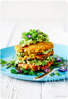 Corn fritters with avocado salsa and leafy greens.