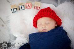 Newborn Baby Boy Wearing Red Crochet Beanie Swaddled In Blue Blanket, Letter Block Props, Newborn Photo, Newborn Picture Ideas, Newborn Photography in Surprise Arizona by Professional Photographer Danielle Jacqueline Photography