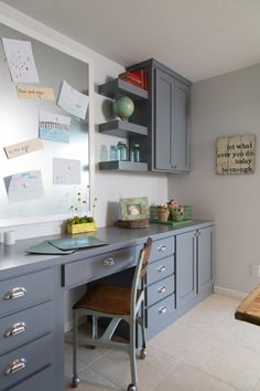 Sign on the wall----Fixer Upper co-host Joanna Gaines turned the once bland laundry room into a colorful and inspiring craft room for Becky Ivy and her daughters.