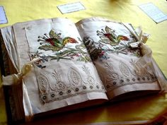 This beautiful, rare French book contains pages that have been embroidered.  It is called a sampler book and is from the 18th century.  Young ladies worked on samplers as a way to perfect their needlework and show off their skills.