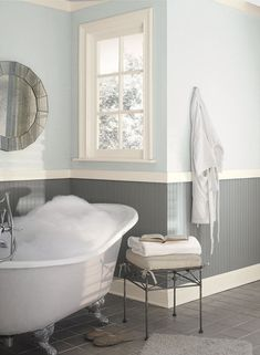 A soft blues  give this bathroom  tranquility  oohhh this bead board cinder color is gorg!