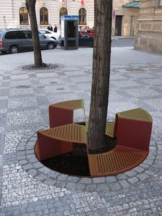 Sinus metal urban bench and tree protector, manufactured by mmcité, designed by Roman Vrtiška (2010) roman-vrtiska.com