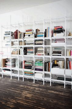White and glass bookshelves.