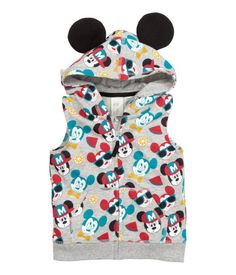 Sleeveless sweatshirt jacket with a printed pattern. Jersey-lined hood with attached ears, zip at front, front pockets, and ribbed hem.