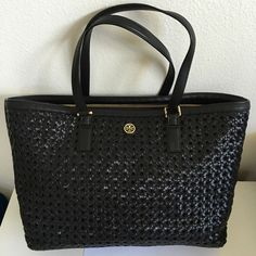 "Tory Burch Robinson Basket-Weave Tote Tory Burch Robinson Basket-Weave East/West Tote with Computer Pocket in black. Double top handles. Open top. One large slightly padded zip compartment. 2 slip interior slip pockets and 1 zip pocket. Approximately 17""(L)x10.5""(H)x5.5""(D). Tory Burch Bags"