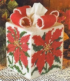 Poinsettia tissue topper cover christmas plastic canvas pattern only from a book Plastic Canvas Stitches, Plastic Canvas Coasters, Plastic Canvas Ornaments, Plastic Canvas Tissue Boxes, Plastic Canvas Crafts, Plastic Canvas Patterns, Plastic Craft, Christmas Decorations To Make, Christmas Crafts