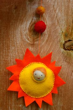 "Summer Solstice Sun Child!!        You will need:  wool felt (in yellow and orange)  one wooden bead  paint & brush  roving (for hair and stuffing)  embroidery floss and needle (in contrasting colour)  beads or wool balls        I used a 250ml mason jar as my circle template...tracing around the lid cut one circle out of your yellow felt, and then cut another ""sun"" sha"