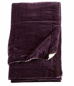 Double bedspread in dark purple with glossy viscose velvet on the front and cotton in a contrasting colour on the back. Thin polyester padding and quilt-stitching.  HM