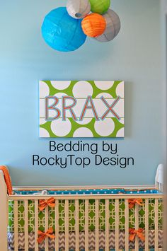 Orange, Aqua, Lime Green and Gray.  Just love this bedding and nursery! www.rockytopdesign.etsy.com