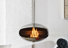 Cocoon Aeris Hanging Fireplace - Polished Steel. For both indoors and outdoors