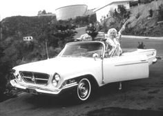 Marilyn monroe in a 1962 Chrysler 300H convertible. Owned by MGM and driven by marilyn.    Google Image