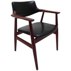 Danish Erik Kirkegaard Teak and Black Vinyl Desk Armchair Midcentury Chair | From a unique collection of antique and modern armchairs at https://www.1stdibs.com/furniture/seating/armchairs/