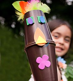 luau activity: have the kids make their own tiki puppet using brown paper cups, brown electrical tape and doodads.