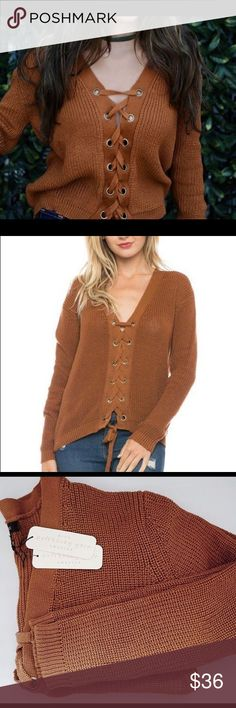 rust colored lace up sweater Long sleeve V-neck lace up sweater Content: 100%POLYESTER Brand: Love Tree Womens Sweaters Full lace up rust/orange love tree Sweaters V-Necks
