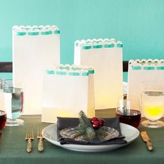 Transform plain white paper bags into luminarias for an inexpensive centerpiece. More Christmas centerpieces: http://www.midwestliving.com/homes/seasonal-decorating/easy-christmas-centerpiece-ideas/?page=19,0