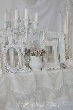 Lacey stuff! Picture Frames! White wedding decor! Love it.