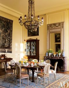 The smaller dining room is furnished with a 17th-century Aubusson tapestry, a Regency rosewood cabinet, a 19th-century English table, and Louis XVI chairs.