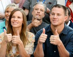 Channing Tatum gives a two thumbs up with Hillary Swank and Jon Stewart at the Telluride Film Festival in Telluride, Colo.