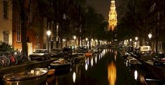 Amsterdam's quiet boats on the canal at night. Photo via Flickr:Bryan T.