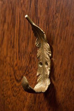 "Pewter Gold Feather Wall and Coat Hook. 1.5""l x 2""w x 5.5""h. Available at #ShopNectar."