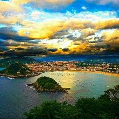 San Sebastian's Mount Igueldo (Spain) offers the best views over the city. From Mount Igueldo you'll have a breathtaking view of La Concha Bay, specially at sunset. In addition, you will find an amazing amusement park and a wooden lighthouse with panoramic views.