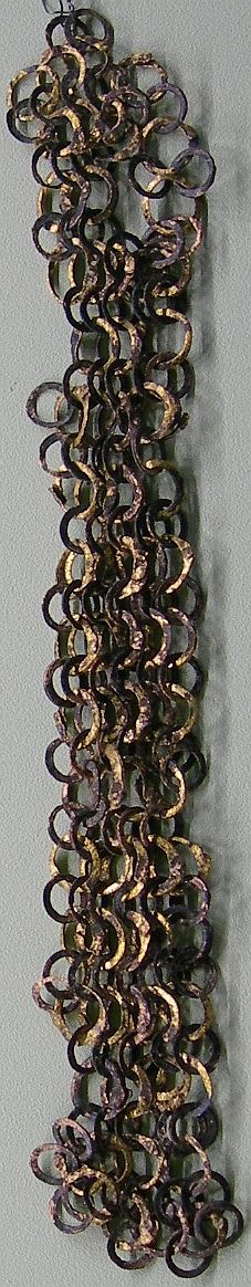 Ancient European (Roman) riveted mail, part of a lorica hamata, with flat section links that still show traces of gilding, Vindonissa Museum.