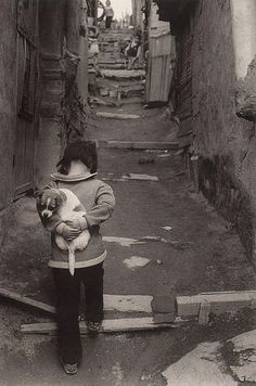 What I see in this pic, a child trying to sneak a pup home. Breaks my heart, but reminds me of an innocent love...a pure love ♥