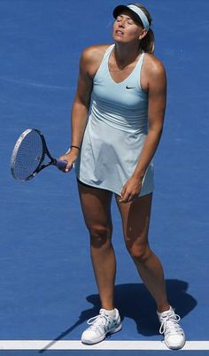Maria Sharapova of Russia reacts after missing a point against Dominika Cibulkova of Slovakia during their fourth-round match at the Australian Open. Sharapova, the women's third seed, lost in three sets. (AP Photo/Eugene Hoshiko)