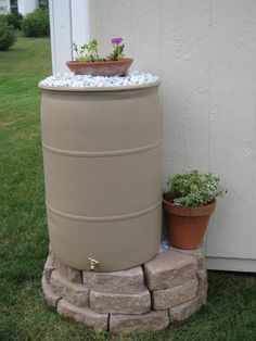 DIY rain barrel - Looks nice with the stones and planter on top. so it's not just a big ugly rain barrel! Garden Yard Ideas, Lawn And Garden, Garden Projects, Garden Landscaping, Backyard Ideas, Landscaping Blocks, Garden Oasis, Large Backyard, Water Garden