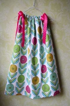 Easiest Pillowcase Dress Ever | Sew Like My Mom    Love the simple approach to arm holes.