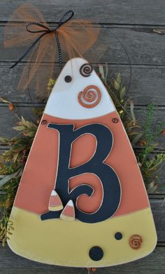 I've seen the Candy Corn Door Hanger before but never w/ the initial on it. I think it looks really cute w/ that little added personal touch. You could get the letter from a craft store and paint it. Holidays Halloween, Halloween Crafts, Happy Halloween, Halloween Decorations, Halloween Party, Halloween Season, Halloween Stuff, Holiday Decorations, Halloween Ideas