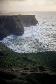 """We survive. We're Irish. We have the souls of poets. We love our misery, we delight in the beauty of strange places and dark places in our hearts."" - Ellis Flynn (Photo: Cliffs of Moher, County Clare, Ireland)"