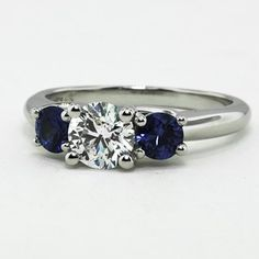 Platinum Three Stone Diamond & Sapphire Trellis Ring, set with .70ct. round diamond. (this is what I hope my engagement ring might look like - this or Sapphire with diamond accents :-D)