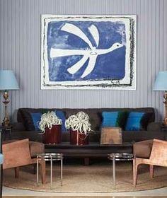 Framed art hanging above sofa