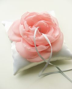 Ring pillow with silk flower