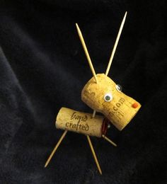 Recycled Champagne Cork Reindeer  (I made these in 2011, however I used 4 Corks, 2 for legs, 1 for the body, & 1 for the head.  The shape of the corks provides character.  Then Brown Pipe Cleaners for the Antlers, and a nice ribbon collar with a Jinge Bell.  I preferred to leave the eyes off.)
