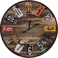 SMP/ Clock made from a barrel lid and license plates.