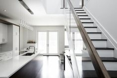 Bright white, dark floors, natural light, sleek surfaces - what is not to like?