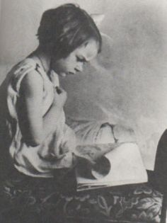Flannery O'Connor reading (intently) as a child.