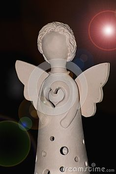 Angel figurine. Candle holder angel figurine with candle.