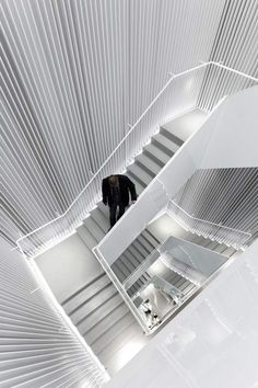 Architects Universal Design Studio have created a perforated pleated facade for clothing retailer H in Seoul, South Korea.The project also involved creating an internal staircase, this the studio lined with vertical louvres.