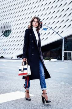Find a long black coat that works for you and combine it with your favorite jeans and sweater for a more sophisticated look.