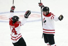 Canada's Dougie Hamilton (R) celebrates his goal with Ryan Murphy against Russia during the first period of their preliminary round game at the 2013 IIHF U20 World Junior Hockey Championship in Ufa, December 31, 2012.