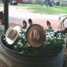 old water tanks. white flowers of all different sizes (for bubbles) some old cowboy boots and hats. Cowboy Bubblebath Oklahoma Style :)