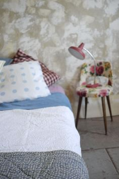 chambray sheets.  grey quilt.  gingham.  polka dots.  love it all.