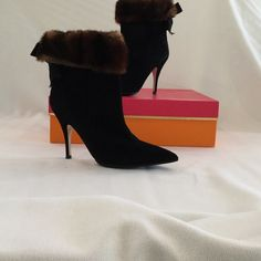 Kate spade mink /suede boot Absolutely stunning 4 inch black suede bootie with brown mink trim and bow on back!!! Love these boots, never worn, too warm where I live. Purchased in Neiman Marcus, wear with jeans to black tie kate spade Shoes Heeled Boots