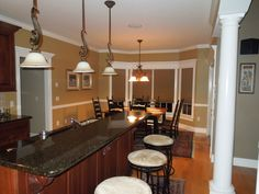 Bar seating in The Derbyville, plan 1032! http://www.dongardner.com/house-plan/1032/the-derbyville. #Kitchen #FloorPlan #OpenConcept