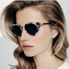 Model Cato van Ee in a pair of ESCADA shades. Selected styles from the collection are available now online.